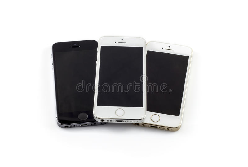 Used Iphone 5S isolated on white. PLOVDIV, BULGARIA - JUNE 16, 2016 - Frontal view of an used three Iphone 5S mobile phones isolated on a white background royalty free stock images