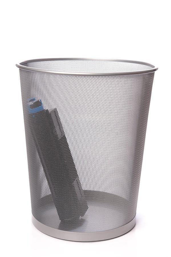 Used laser printer cartridge. Used laser printer toner cartridge in metal trash bin over white stock image