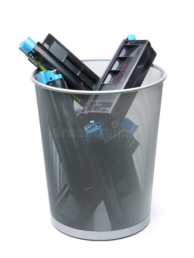 Used laser printer cartridges. In metal trash bin over white royalty free stock images