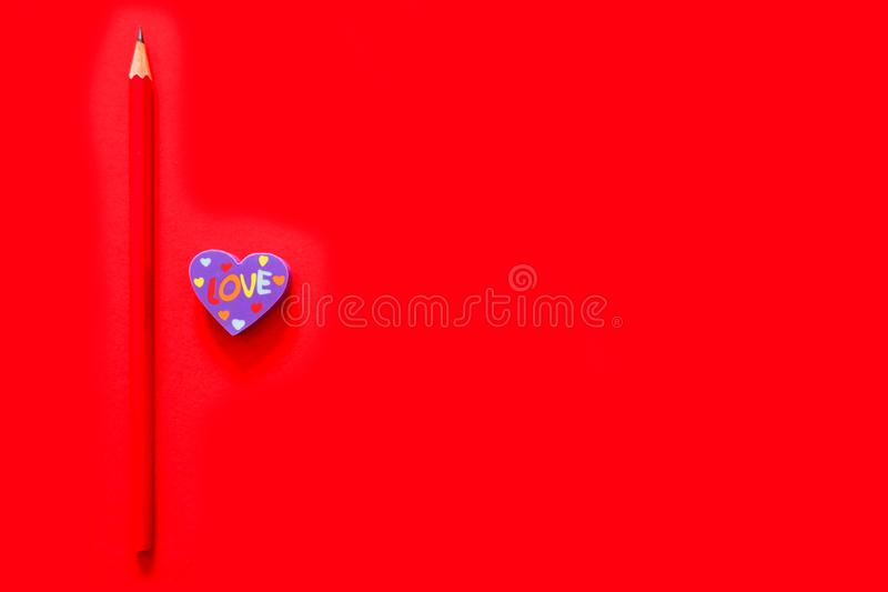 Used Love Pink and Purple Eraser Symbol for Valentine Day Concept. Education Toy Top View. Colorful Heart Erasers and Red Pencil stock photography