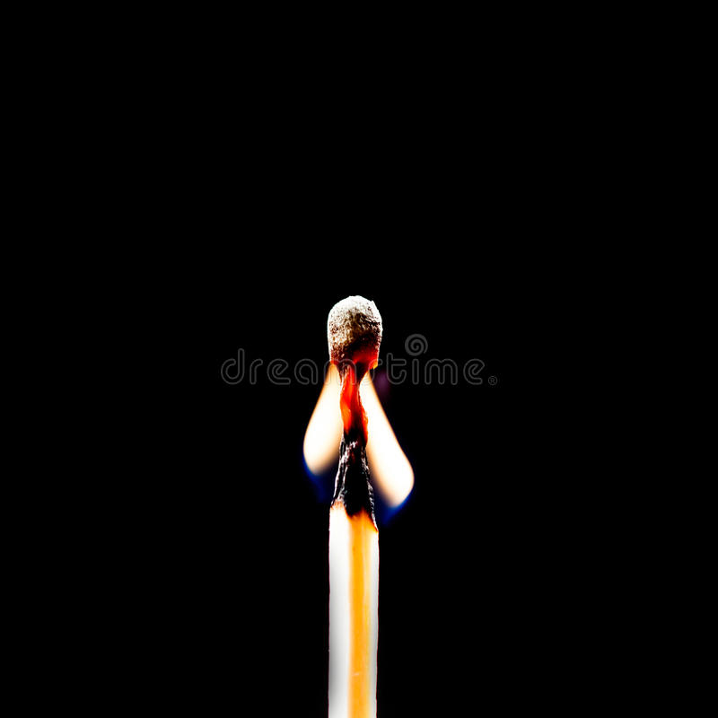 Used match and flame. With black background royalty free stock images