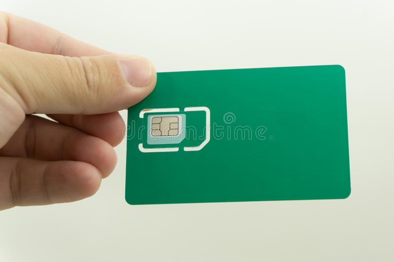 Used mobile phone sim card macro isolated on white royalty free stock photos