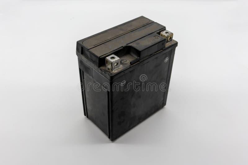 Used motorcycle black battery isolated on white stock photo