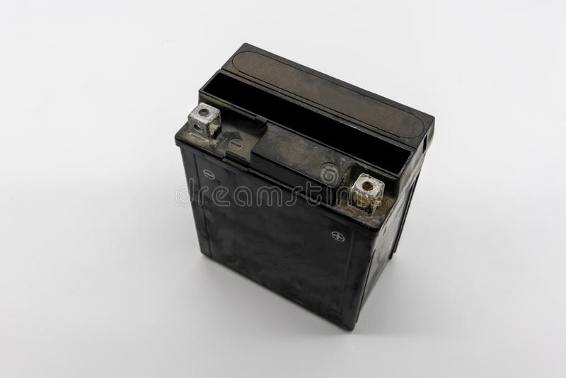 Used motorcycle black battery isolated on white stock photography
