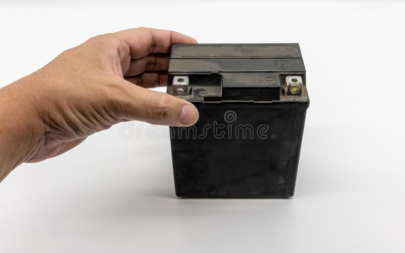 Used motorcycle black battery  on white royalty free stock photo
