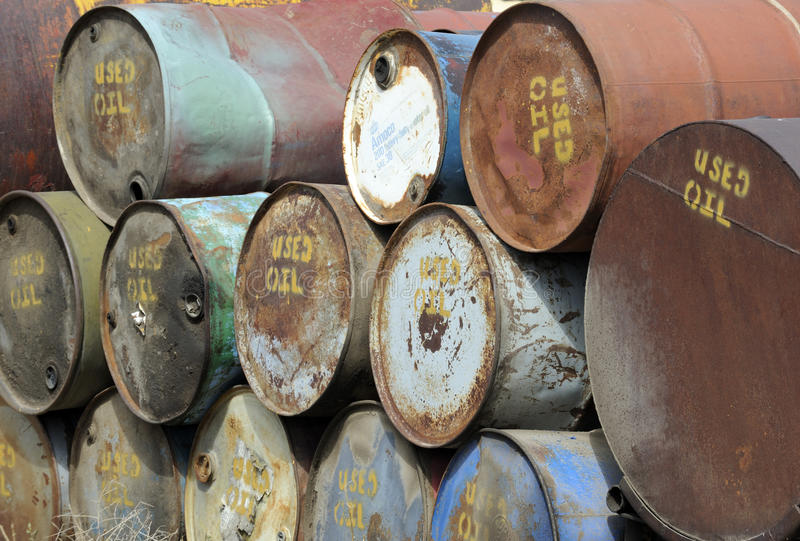 Used oil drums stock photos