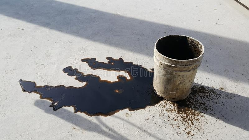 Used oil spill is on the floor. royalty free stock images