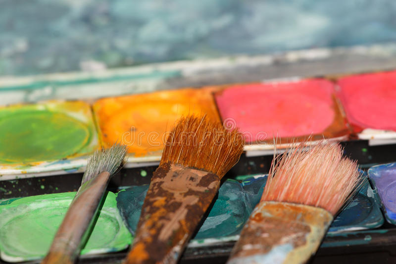 Used paint brushes on watercolors royalty free stock photo