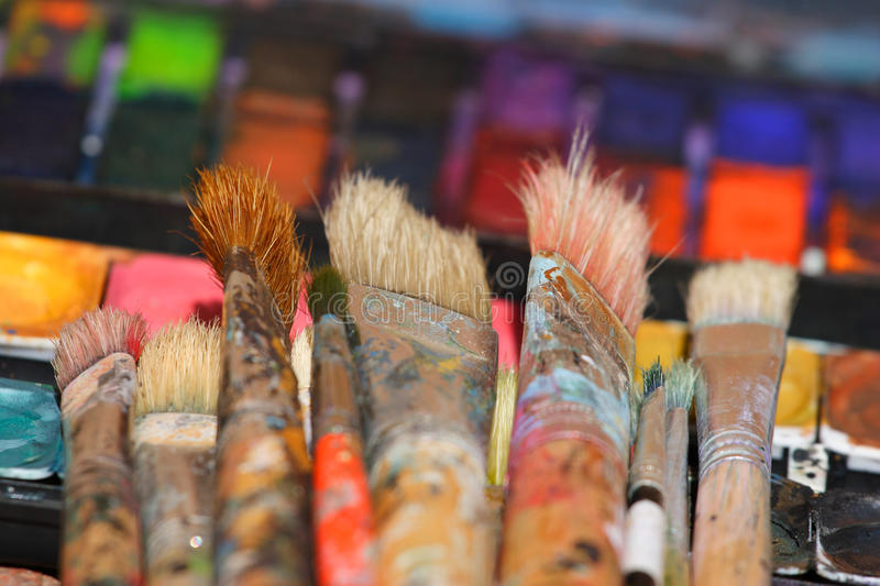 Used paint brushes on watercolors stock photo