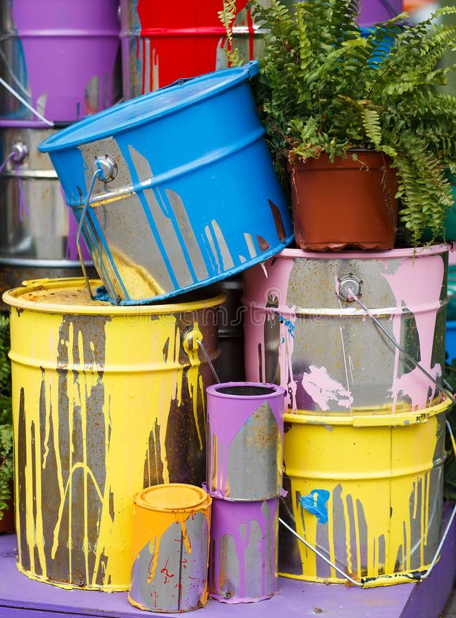 The used paint cans. Many multi-colored buckets with traces of paint on them.  royalty free stock photography