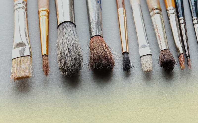 Used Paintbrushes On Gray Background Macro View Different Size