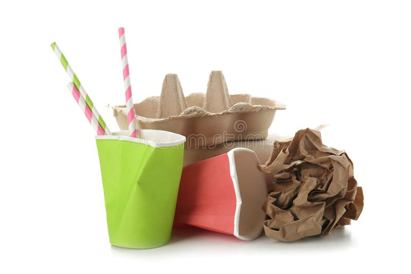 Used paper packages on white background. Recycling concept royalty free stock image