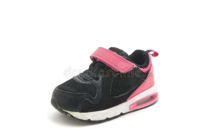 Used pink - black shoe for kids isolated on white background royalty free stock photography