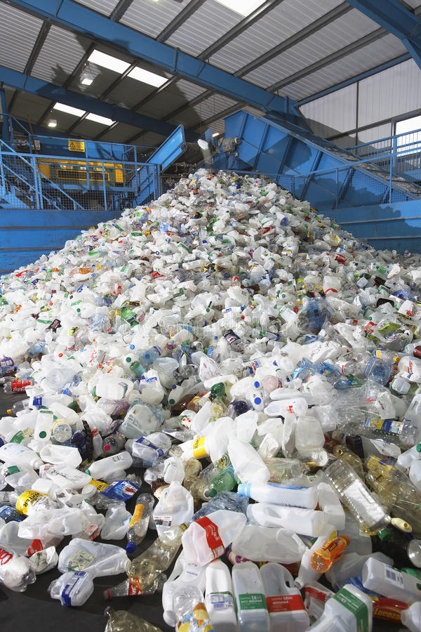 Used Plastic Bottles In Recycling Factory. Heap of used plastic bottles in recycling factory stock photography
