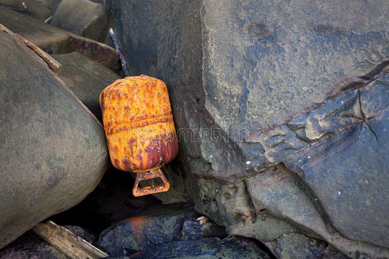 Used rusty gas cylinder in shore royalty free stock images