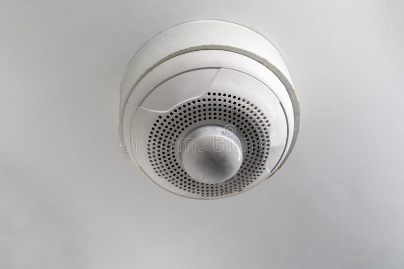 Used smoke detector of fire alarm isolated on white royalty free stock photo