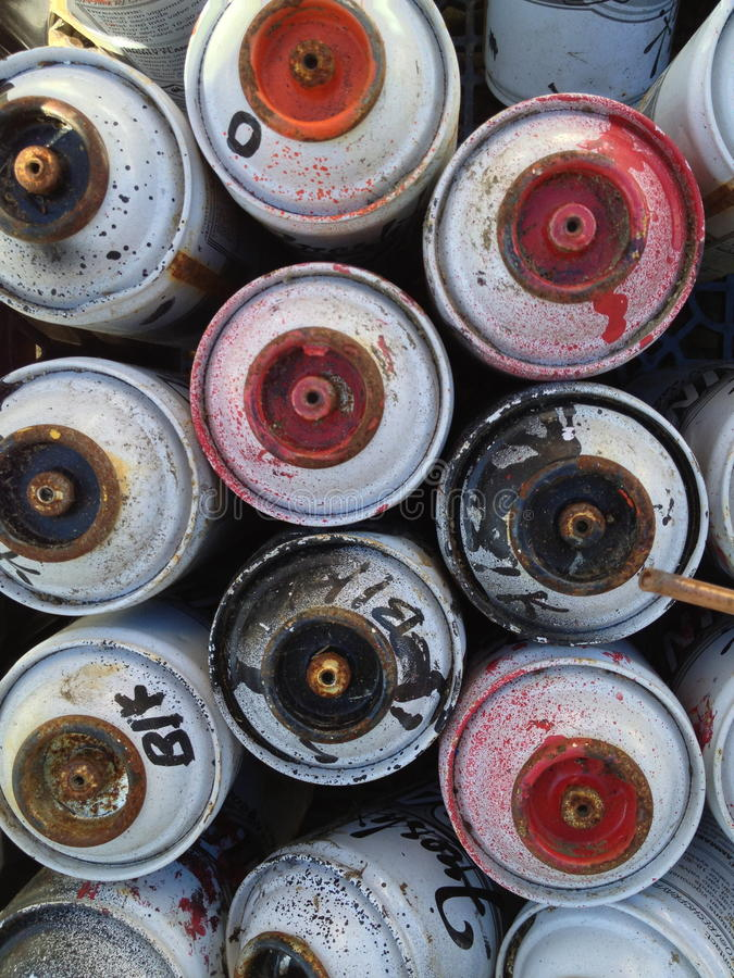 Used spray paint cans stock images