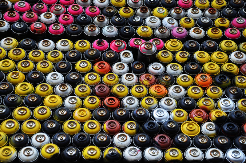 Used spray paint cans stock image