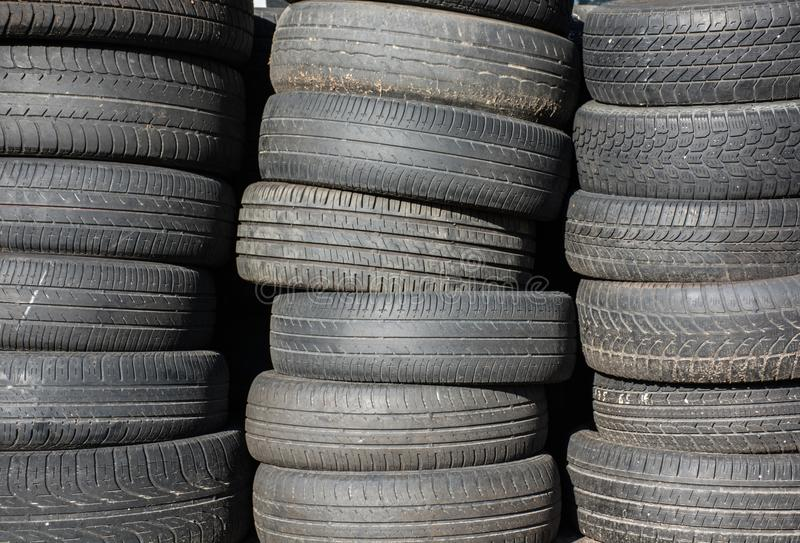 Used and stacked car tires. Black used and stacked car tires royalty free stock photos