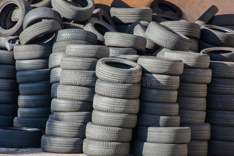 Used and stacked car tires. Black used and stacked car tires stock photos