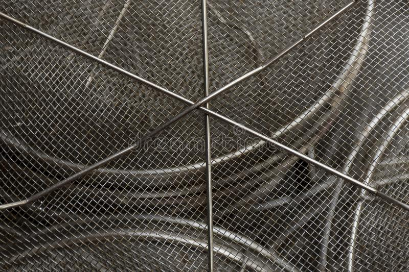 Used steel wire mesh filter. Centre in sharp focus and surface curves. Used steel wire mesh filter. Centre in sharp focus and surface curves away from view royalty free stock photos