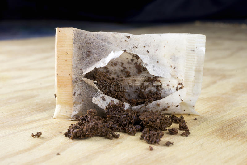 Used tea bag. On a wooden table stock photos