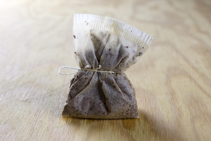 Used tea bag. On a wooden table stock photography