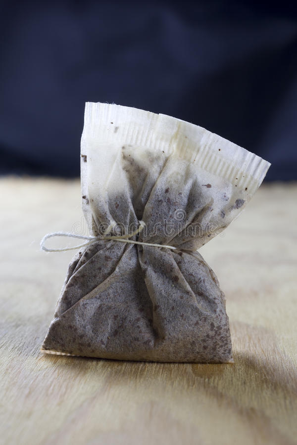 Used tea bag. On a wooden table royalty free stock photography