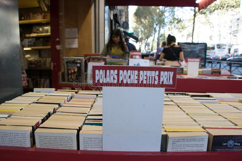 Used thriller French language books sold at small prices in Saint Michel royalty free stock photo