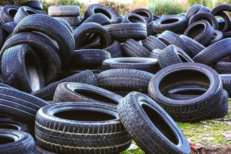 Used tires in a recycling yard stock photo
