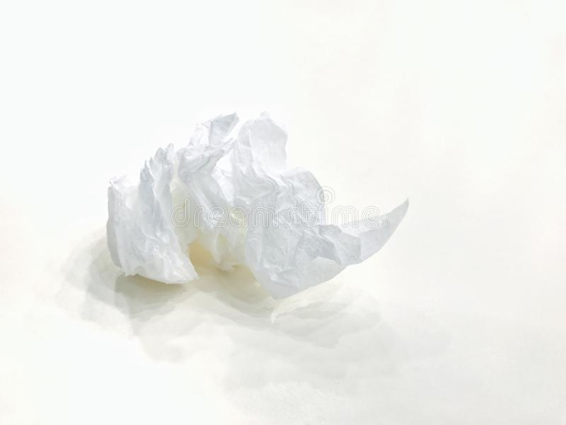 Used tissues trash, bin rolls of toilet paper used, Dirty paper wipe ball on white background. stock image