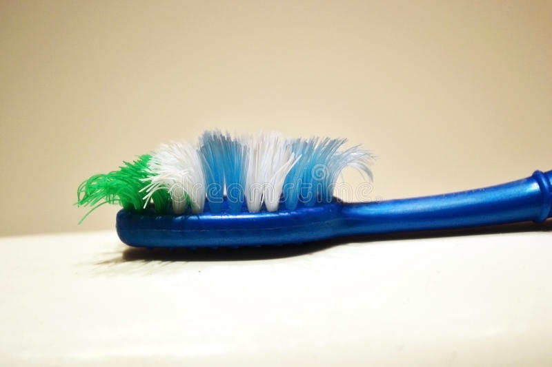 Used tooth brush on a blurred background royalty free stock image