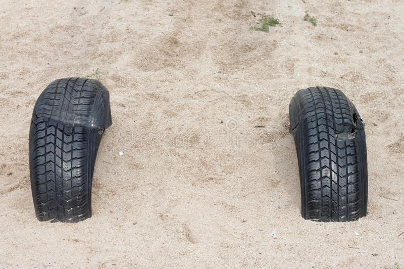 Modify Tire in playground. Used of two tire in the sand of playground stock image