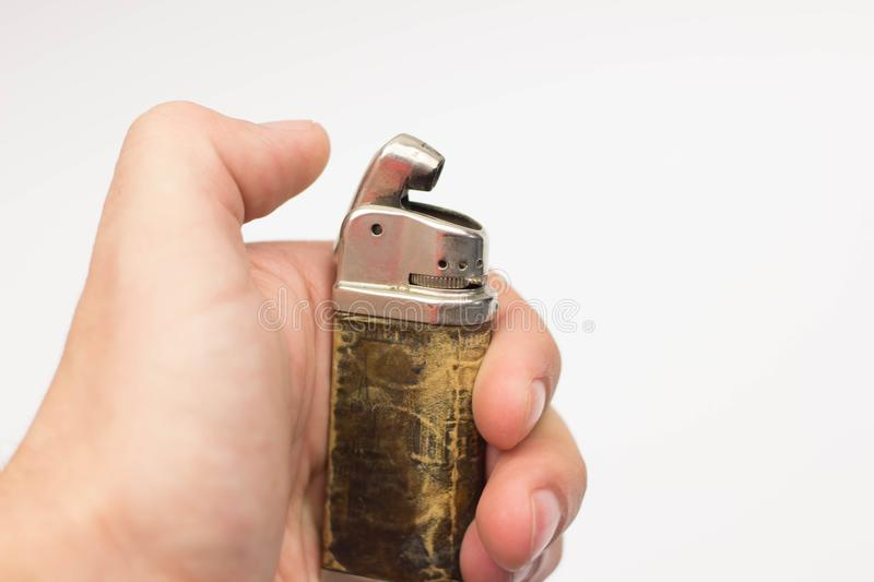 Used vintage metal lighter isolated on white. Background royalty free stock photo