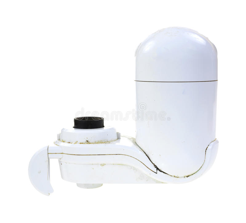 Used water filter. Side view of a used water filter showing dirt and grime on a white background stock photos