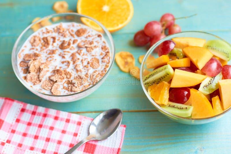Useful breakfast from porridge and fruit stock photo