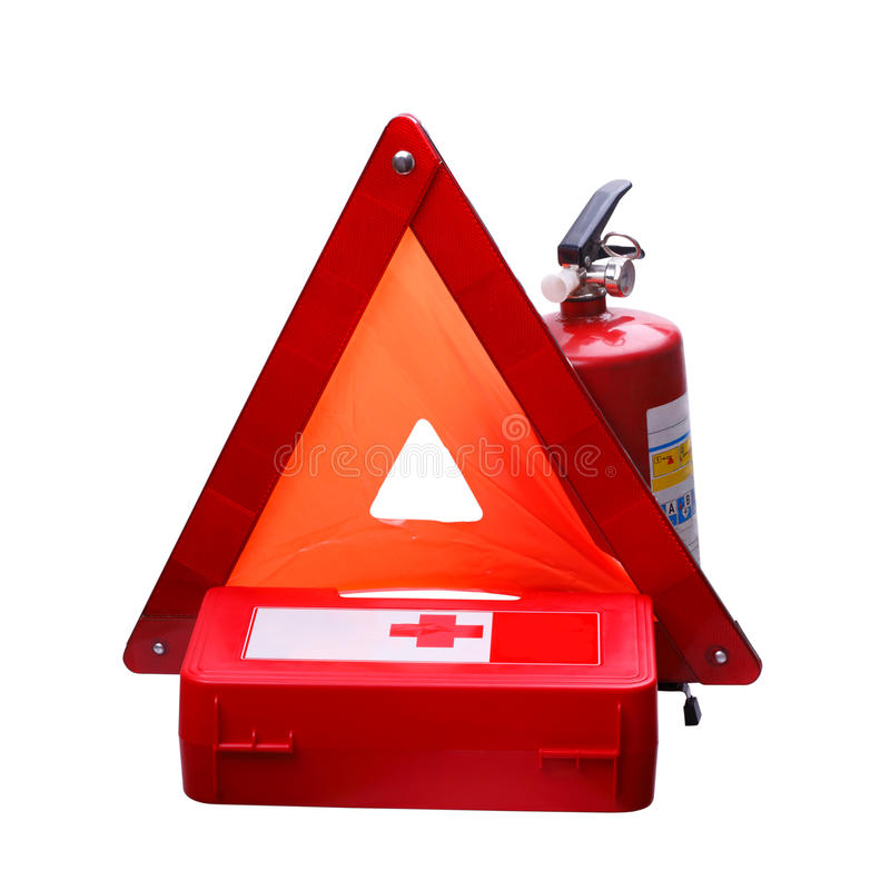 Useful equipment for a car. First Aid Kit, Warning Triangle and Fire Extinguisher on a white background stock images