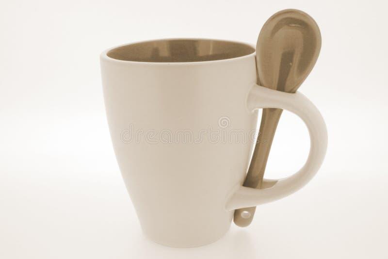 Useful mug and spoon royalty free stock image