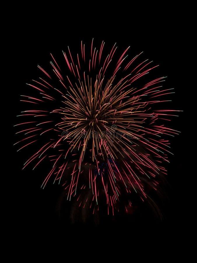Firework blast isolated on black stock images