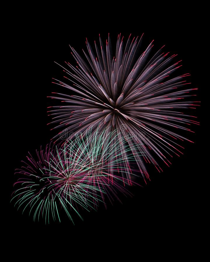 Sparks trails of fireworks blasts isolated on black stock photography