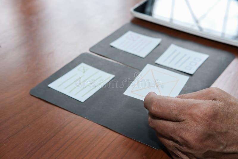 User experience, UX designer designing web on tablet layout. UI. User experience & x28;UX& x29; designer designing web on smart phone layout. UI planning mobile royalty free stock image