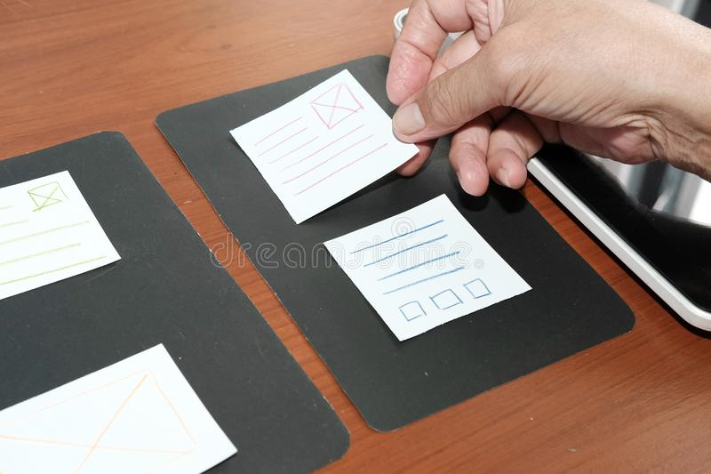 User experience, UX designer designing web on tablet layout. UI. User experience & x28;UX& x29; designer designing web on smart phone layout. UI planning mobile stock images