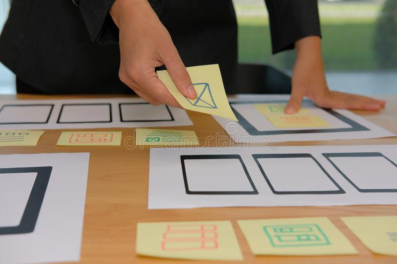 User experience UX designer designing web on smartphone tablet l. User experience, UX designer designing web on smart phone tablet layout. UI planning mobile stock photography