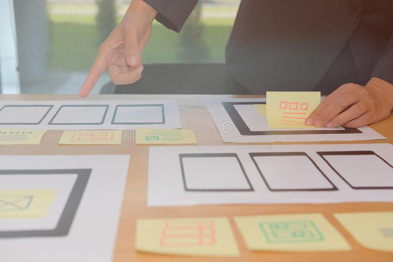 User experience UX designer designing web on smartphone tablet l. User experience, UX designer designing web on smart phone tablet layout. UI planning mobile stock photos