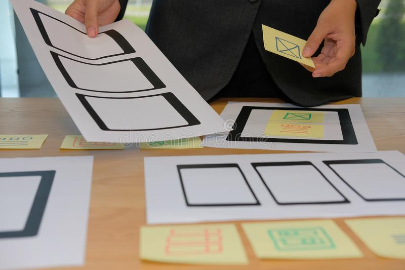 User experience UX designer designing web on smartphone tablet l. User experience, UX designer designing web on smart phone tablet layout. UI planning mobile stock images