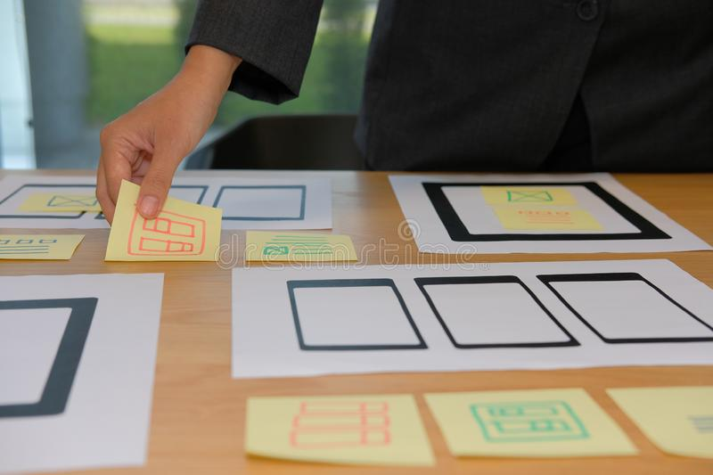 User experience UX designer designing web on smartphone tablet l. User experience, UX designer designing web on smart phone tablet layout. UI planning mobile royalty free stock images