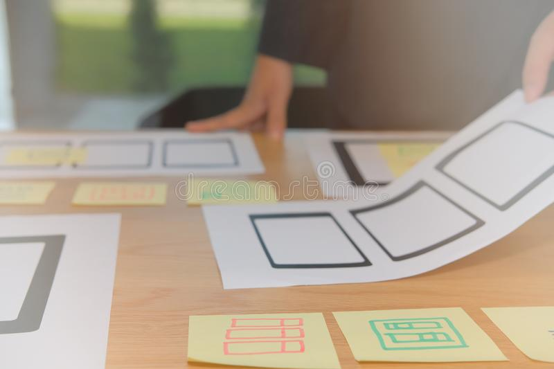 User experience UX designer designing web on smartphone tablet l. User experience, UX designer designing web on smart phone tablet layout. UI planning mobile royalty free stock photography