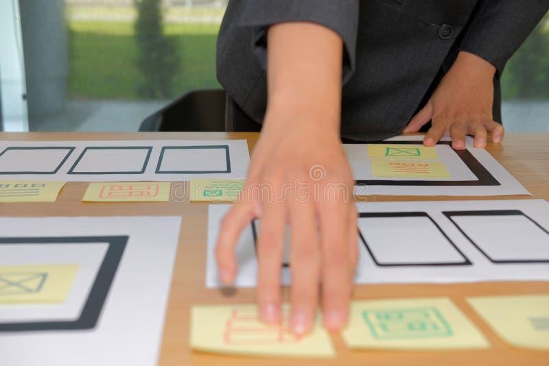 User experience UX designer designing web on smartphone tablet l. User experience, UX designer designing web on smart phone tablet layout. UI planning mobile stock image