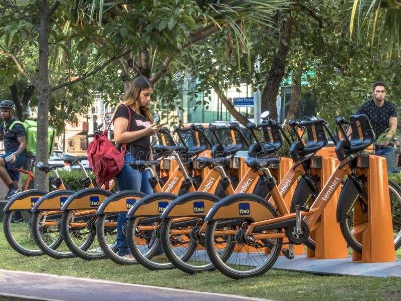 Users access the APP for Urban bikes for hire in Tembici Station of Bike in Faria Lima Avenue. Sao Paulo, Brazil, December 14, 2018. users access the APP for stock photo