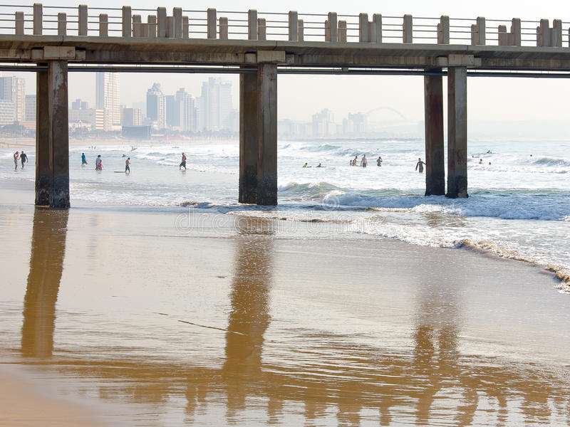 UShaka and Moyo`s Pier at Durban`s main beachfront. This view features the iconic Durban city skyline and the football stadium built for the 2010 World Cup royalty free stock images